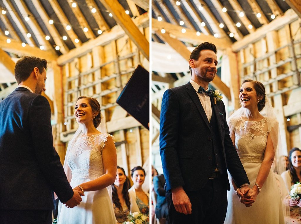 smiling couple during barn ceremony