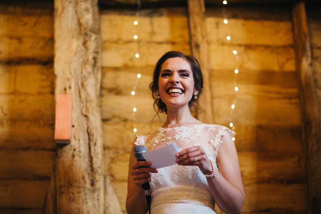 bride doing a speech at the great barn kent