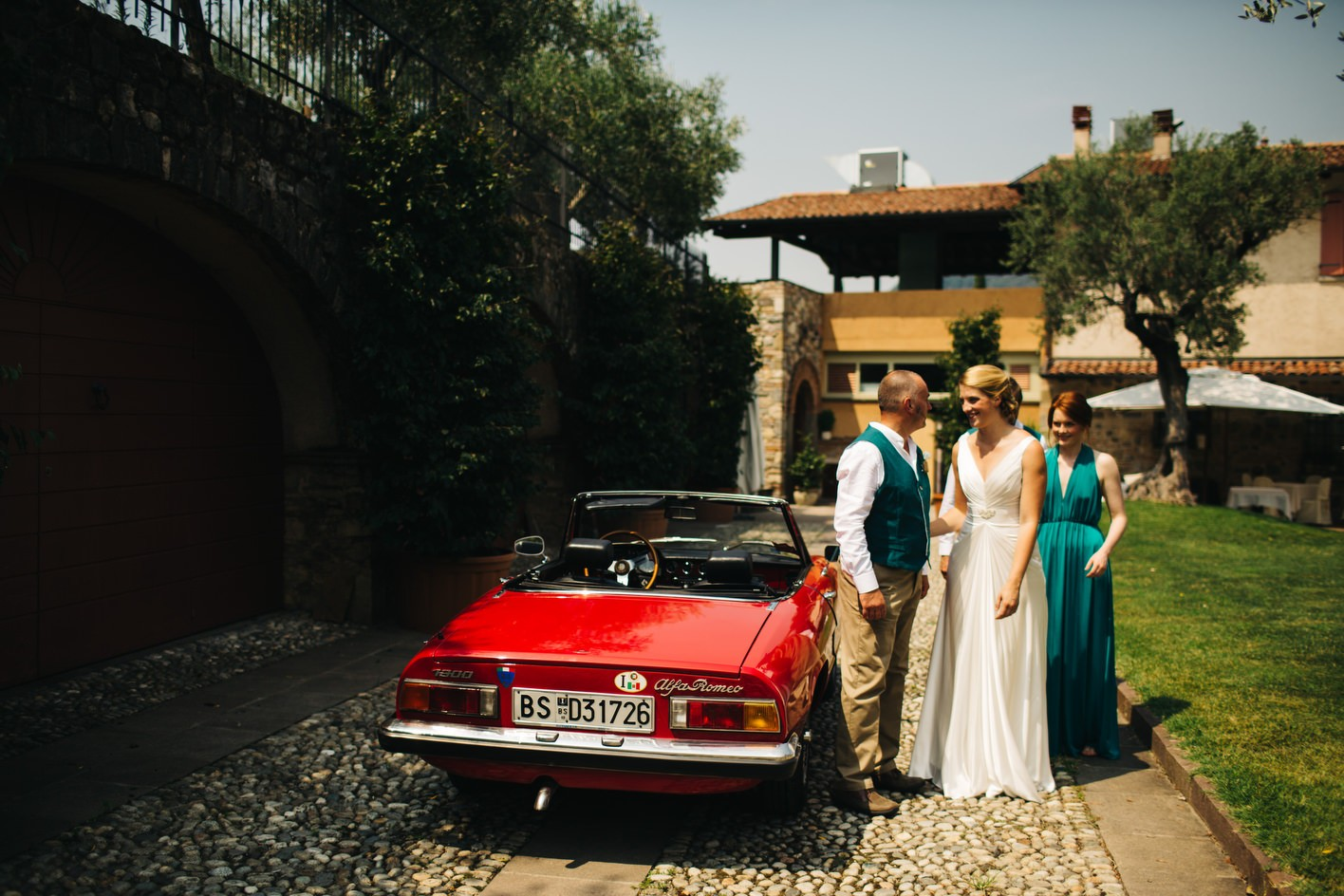 bride arriving in italian vintage car
