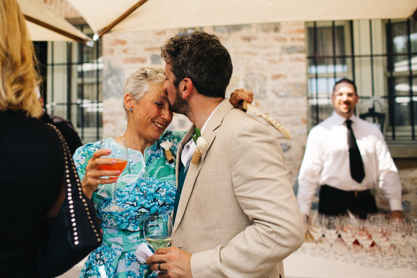 groom kisses mother