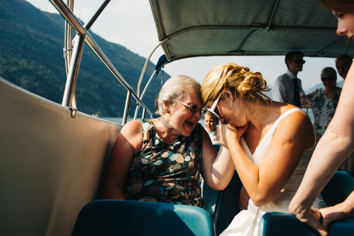 Bride sharing moment with grandmother on Lake Iseo boat