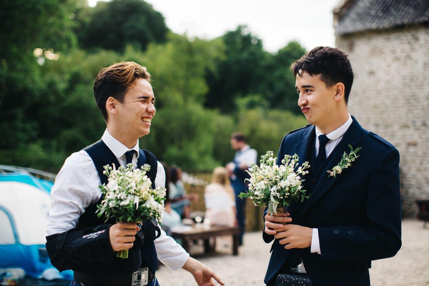 ushers holding bouquet