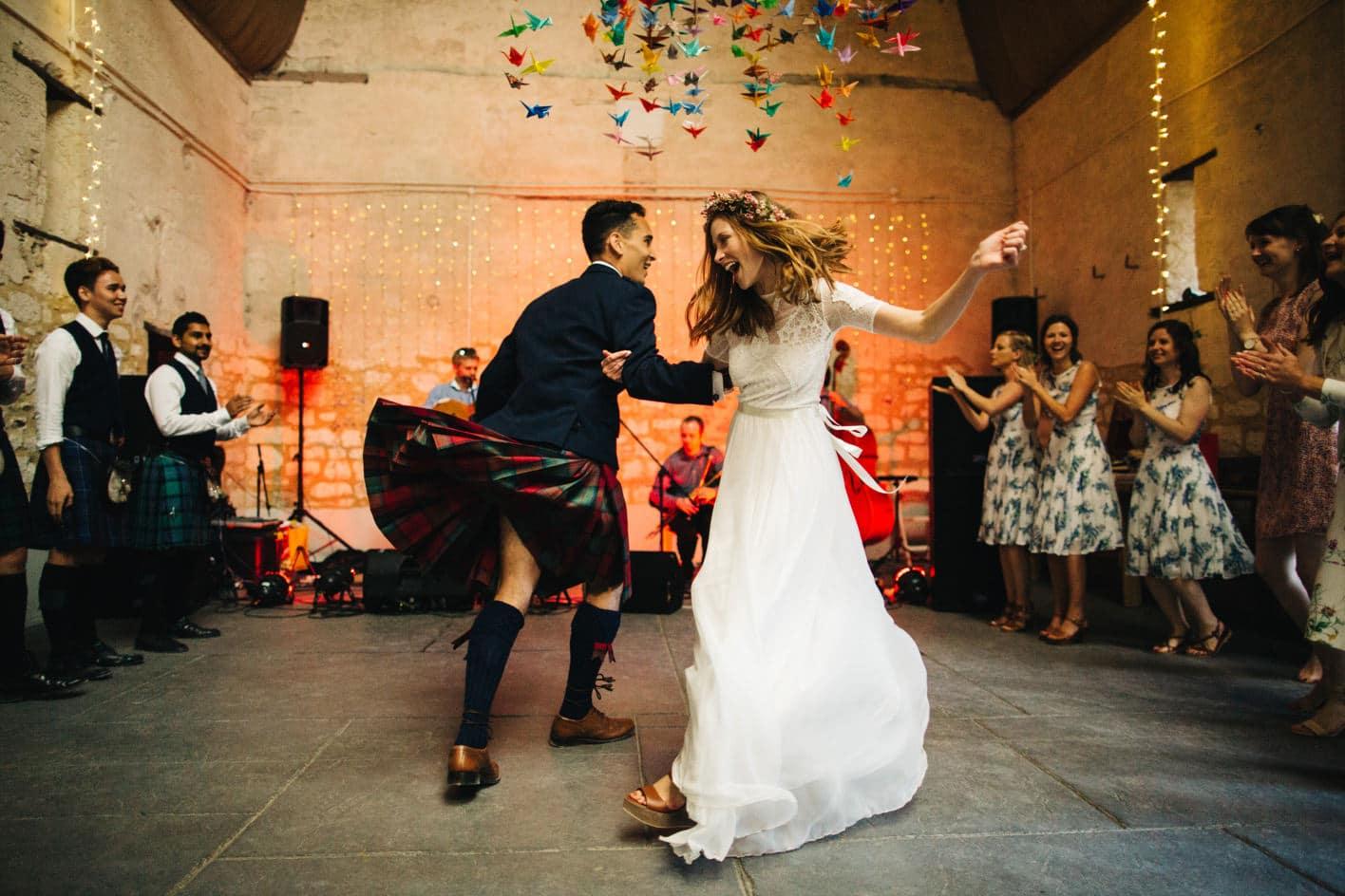 bride and groom ceilidh dancing