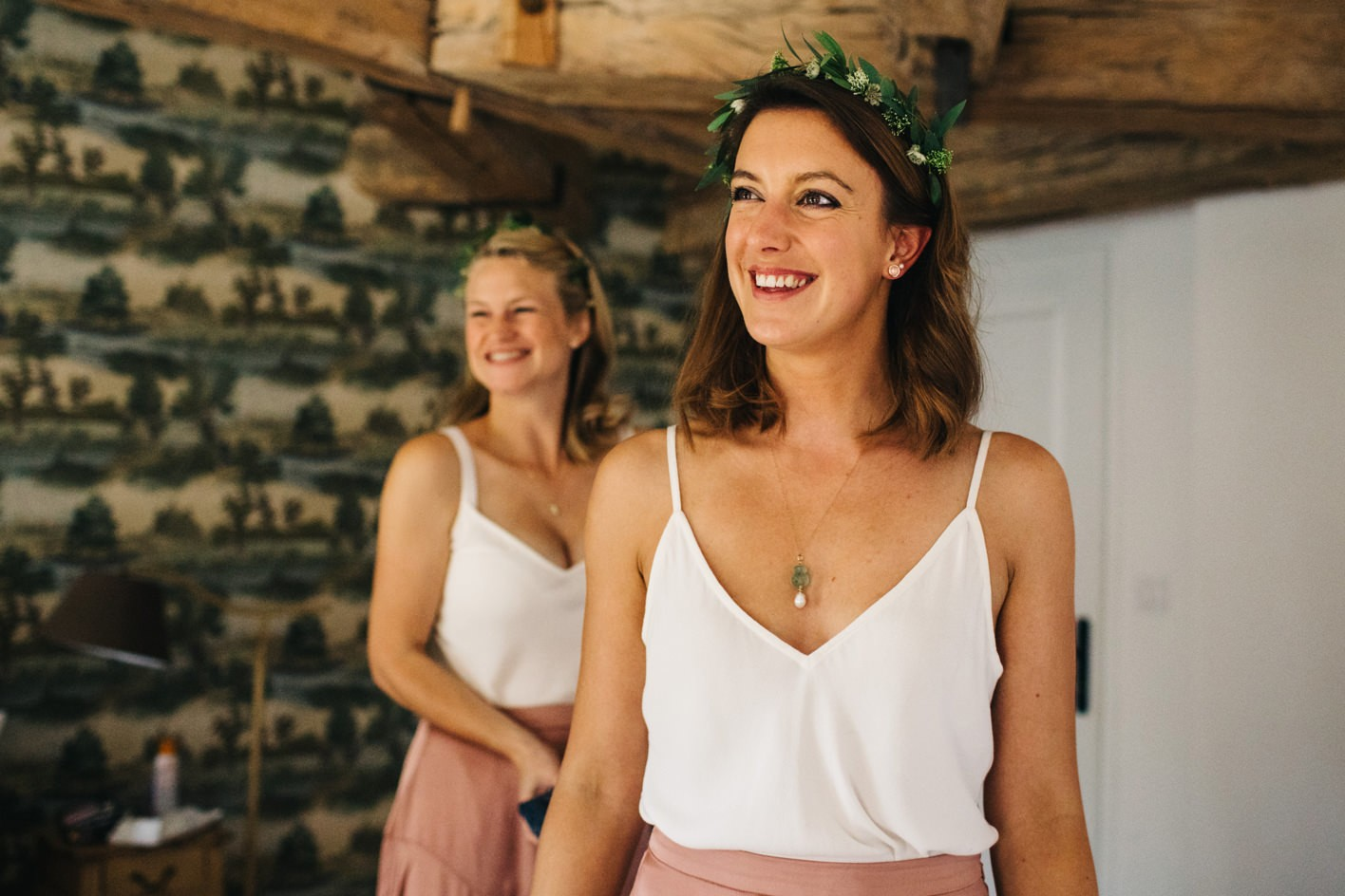 bridesmaids smile at bride