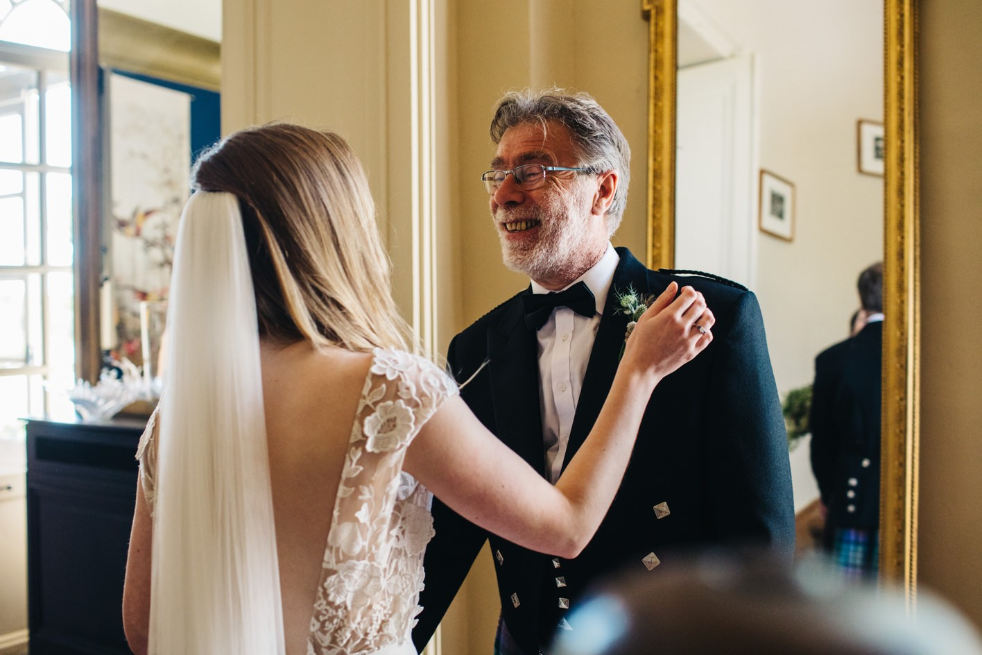 father of bride sees daughter