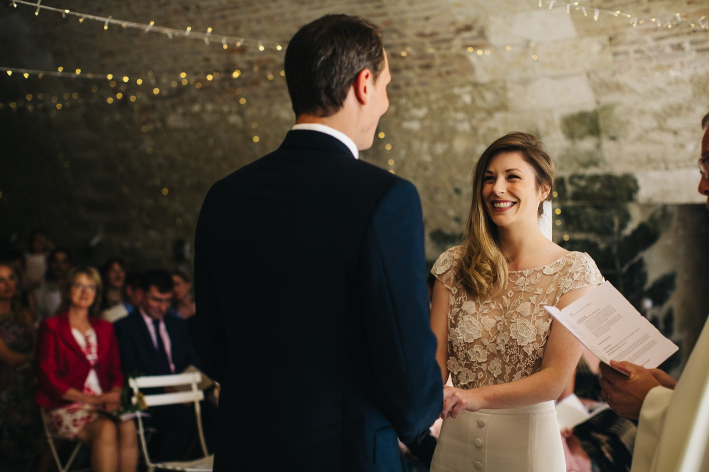 laughing bride stares at her husband