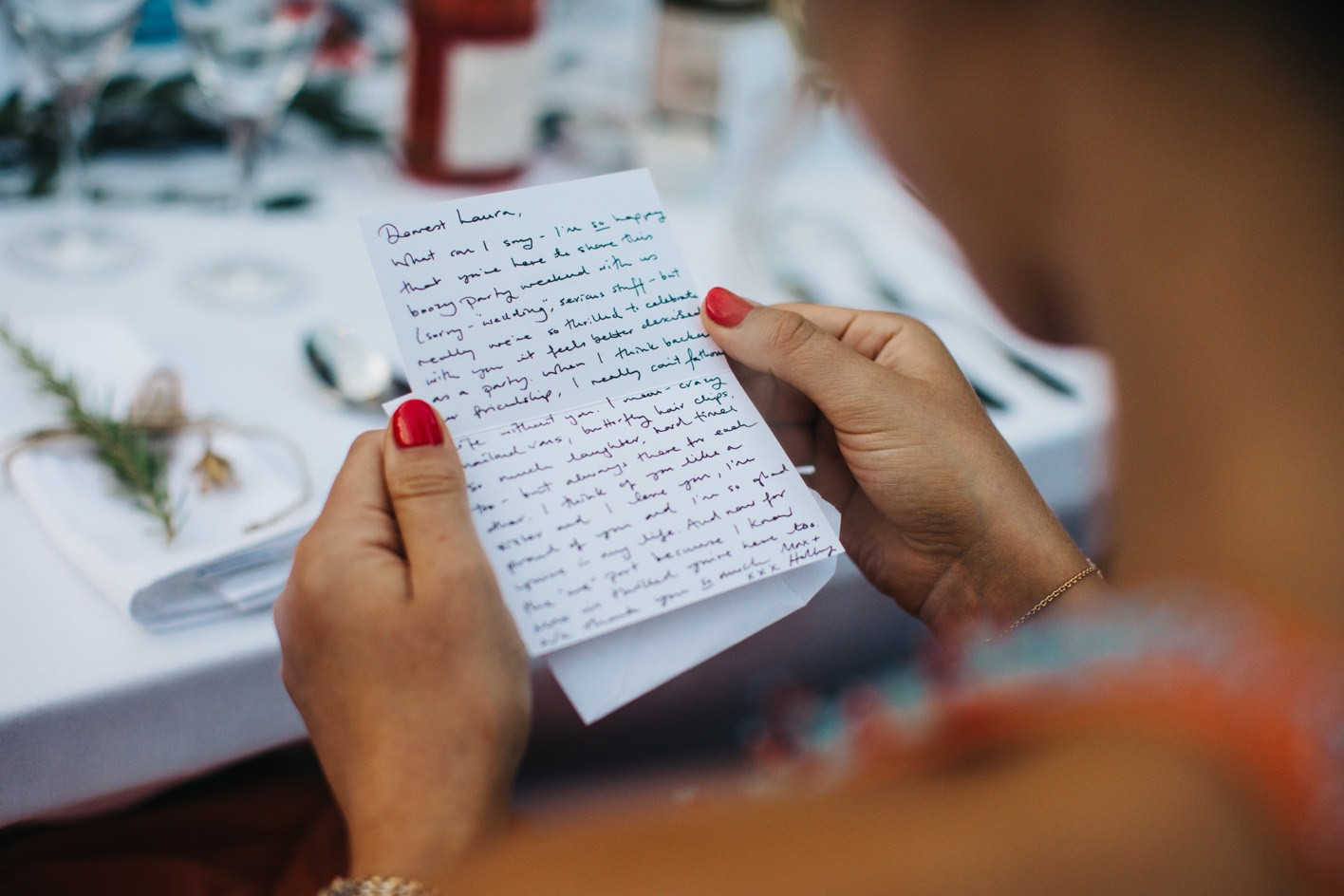 handwritten wedding note for guest on table