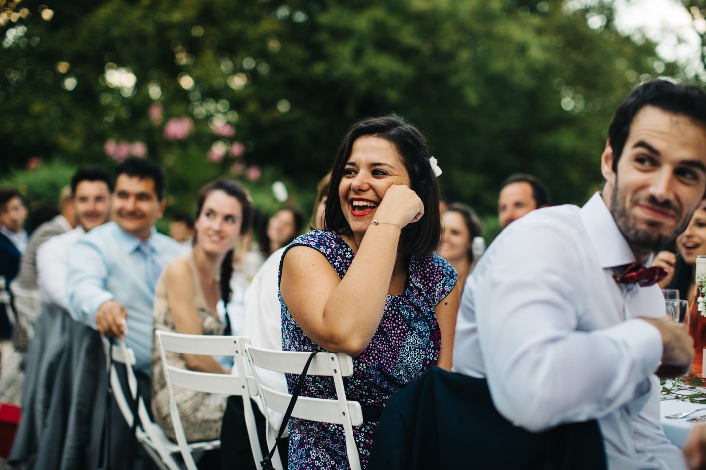 wedding guest laughing during speech