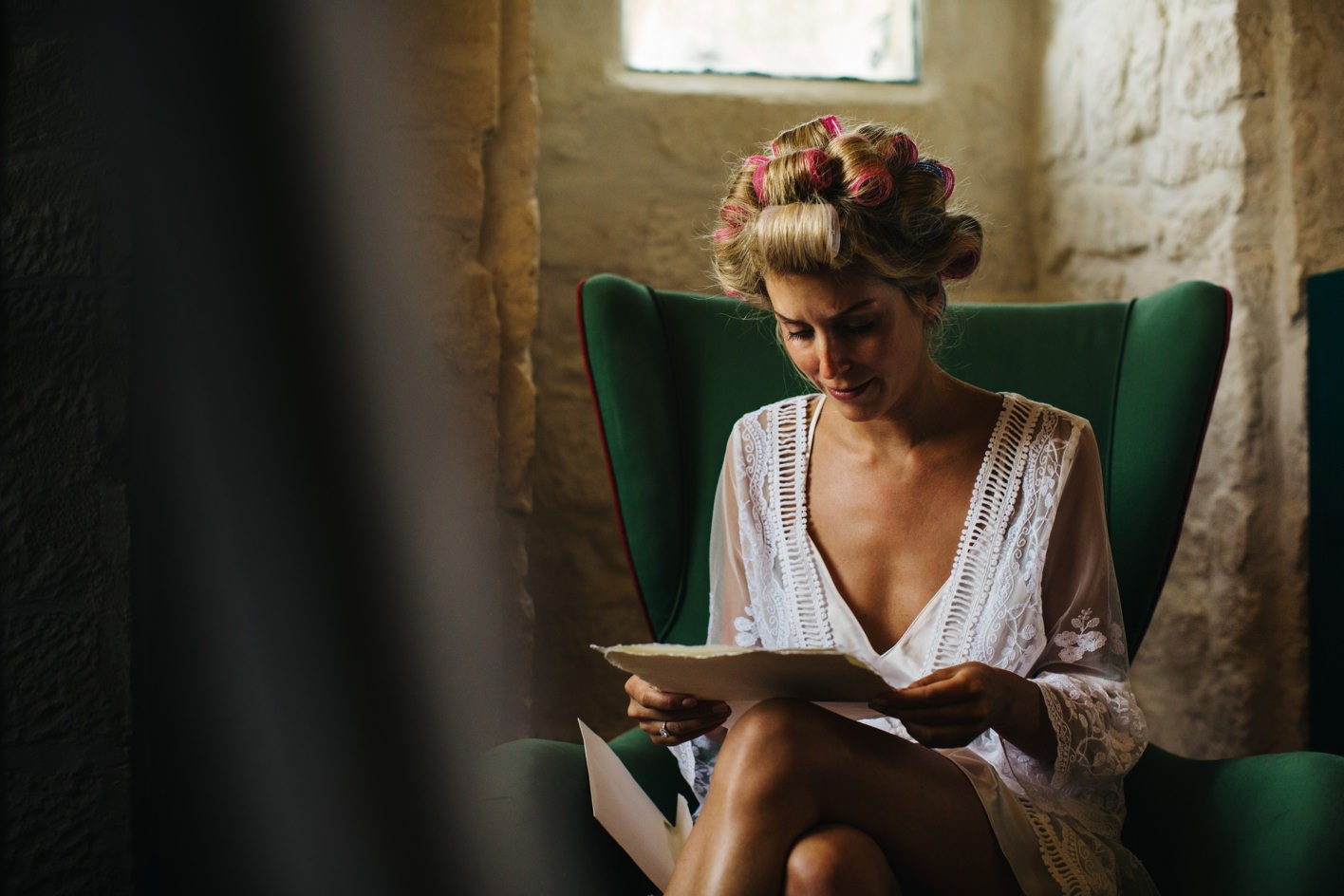 bride reads letter from groom on morning of wedding