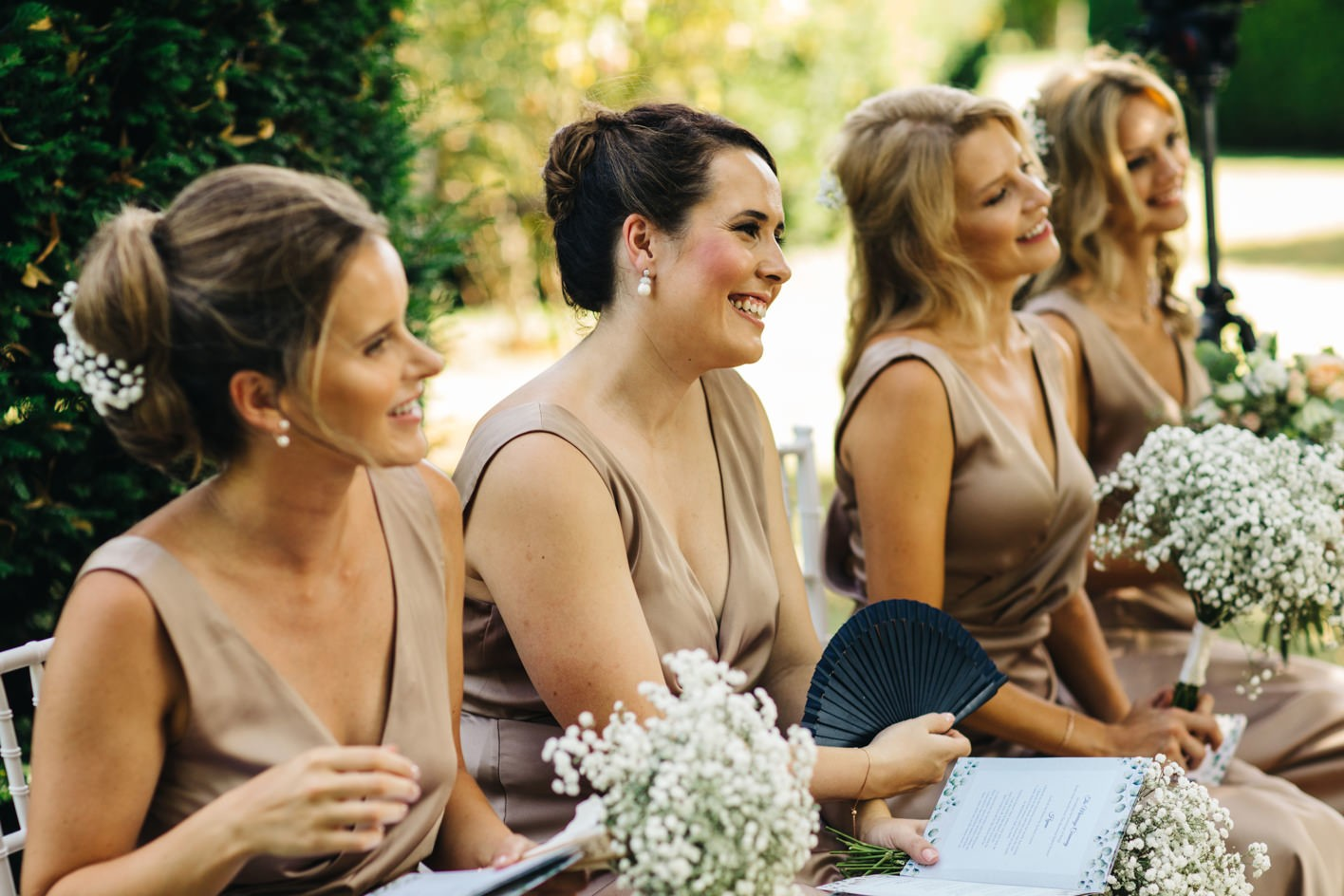 bridesmaids smile during vows