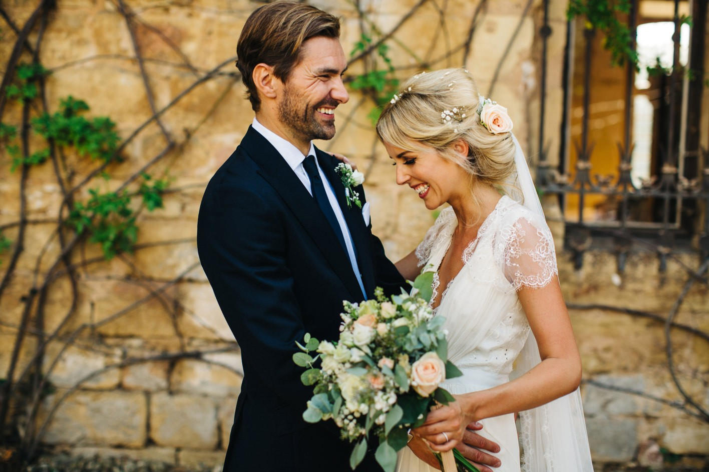 bride with groom wearing jenny packham dress