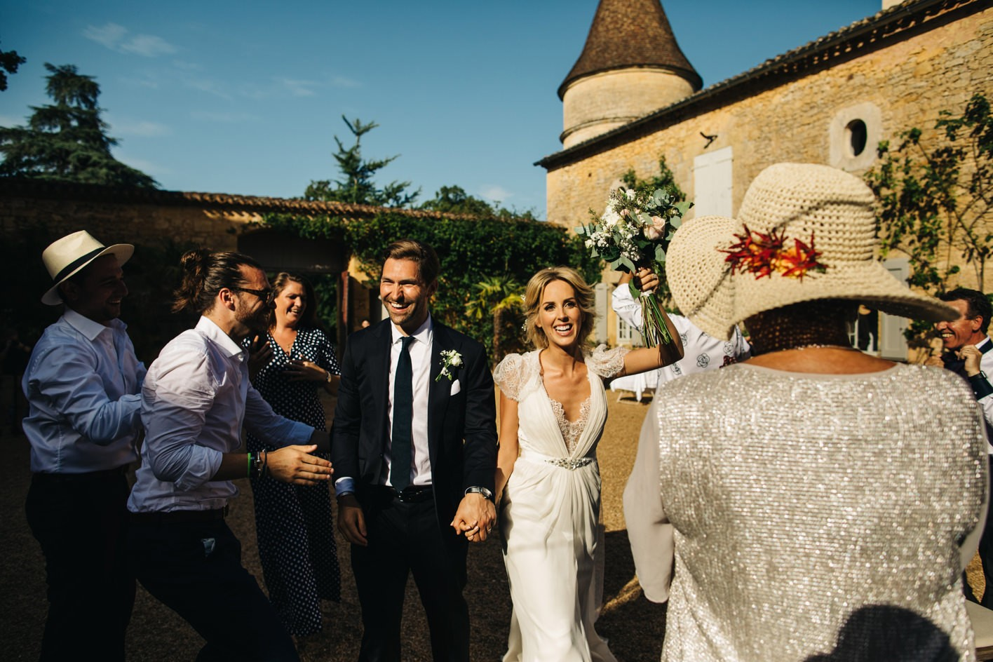 couple making entrance at chateau de la bourlie