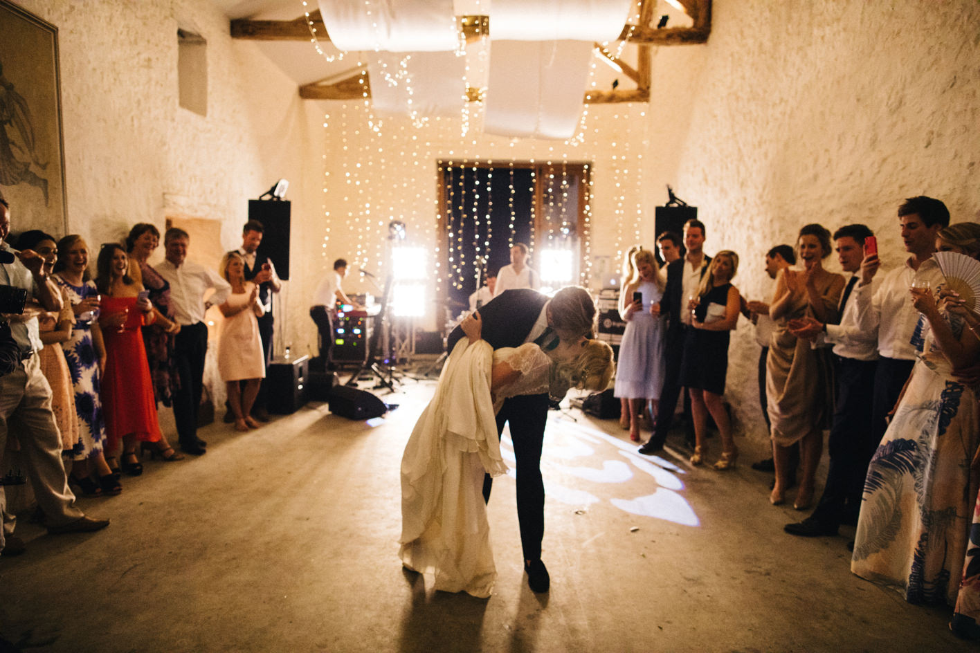 groom bends bride backwards at first dance