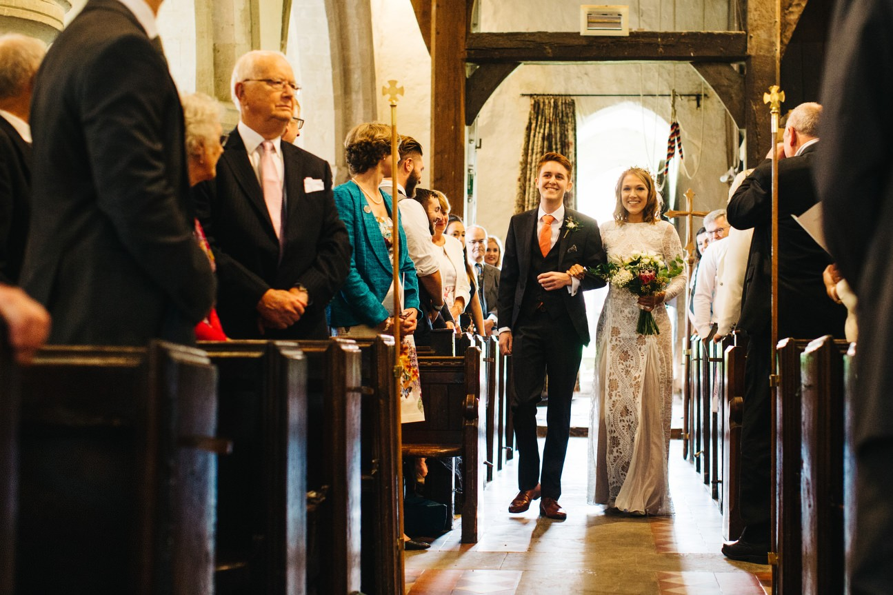 couple walk down aisle together