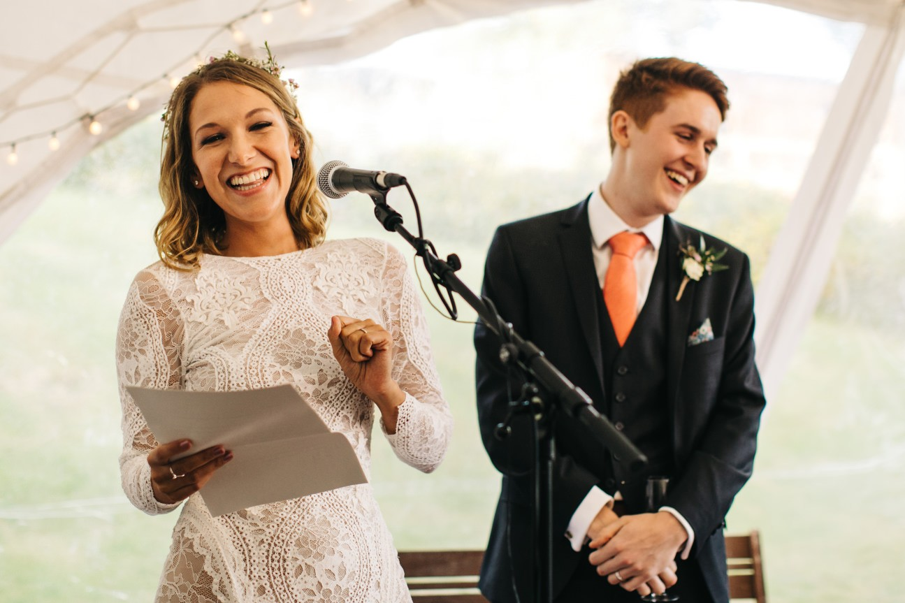 couple laugh during speech