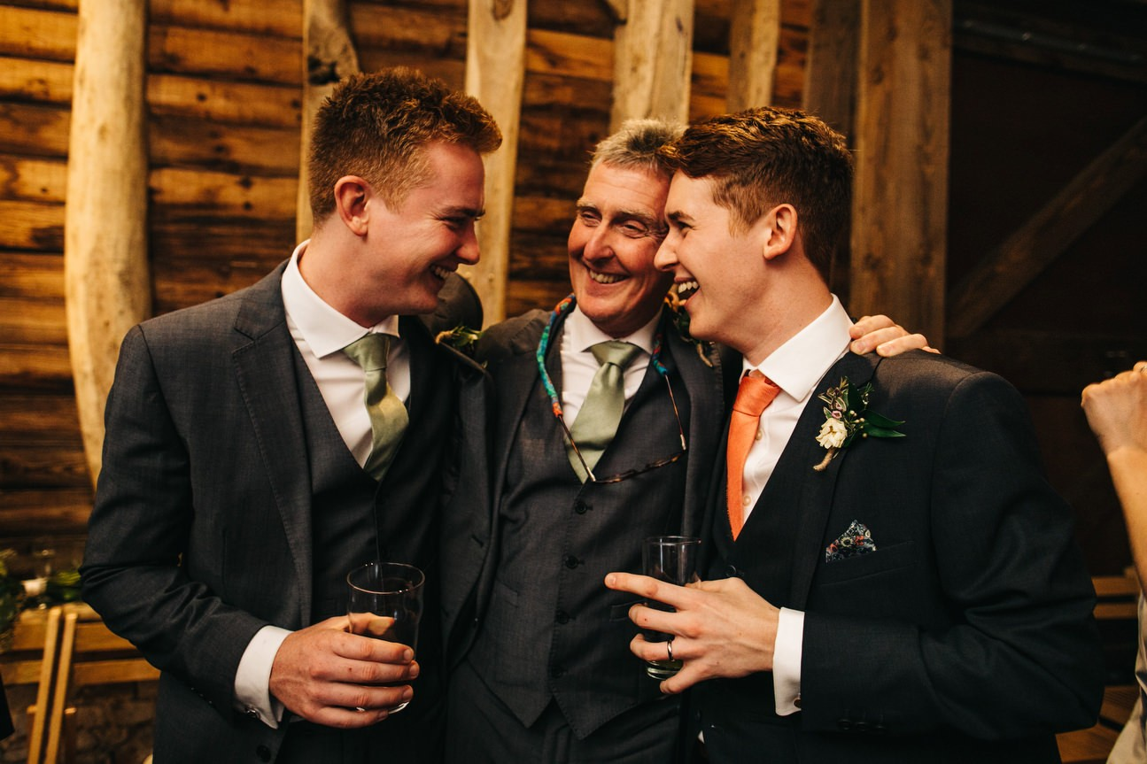 groom with usher and father