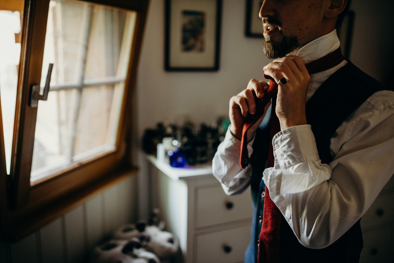 groom getting ready on morning of wedding