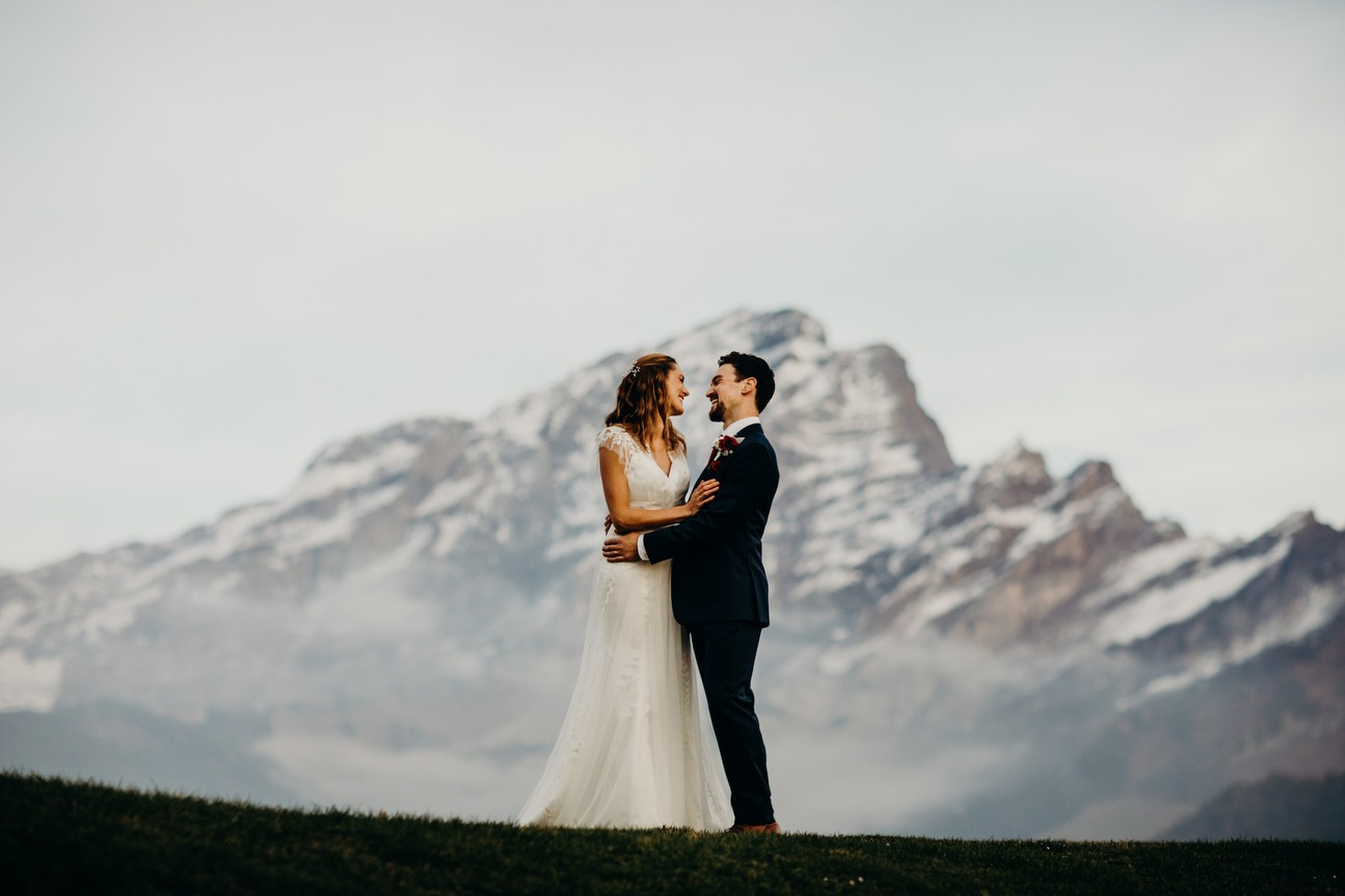 Bride and groom with Chaux Ronde mountain in background