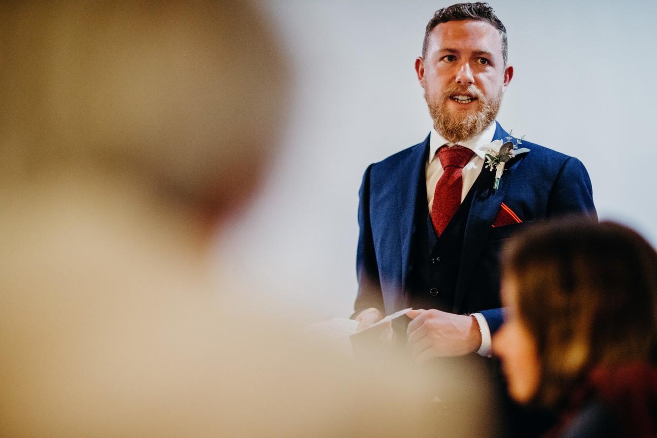 groom starting speech at chalet