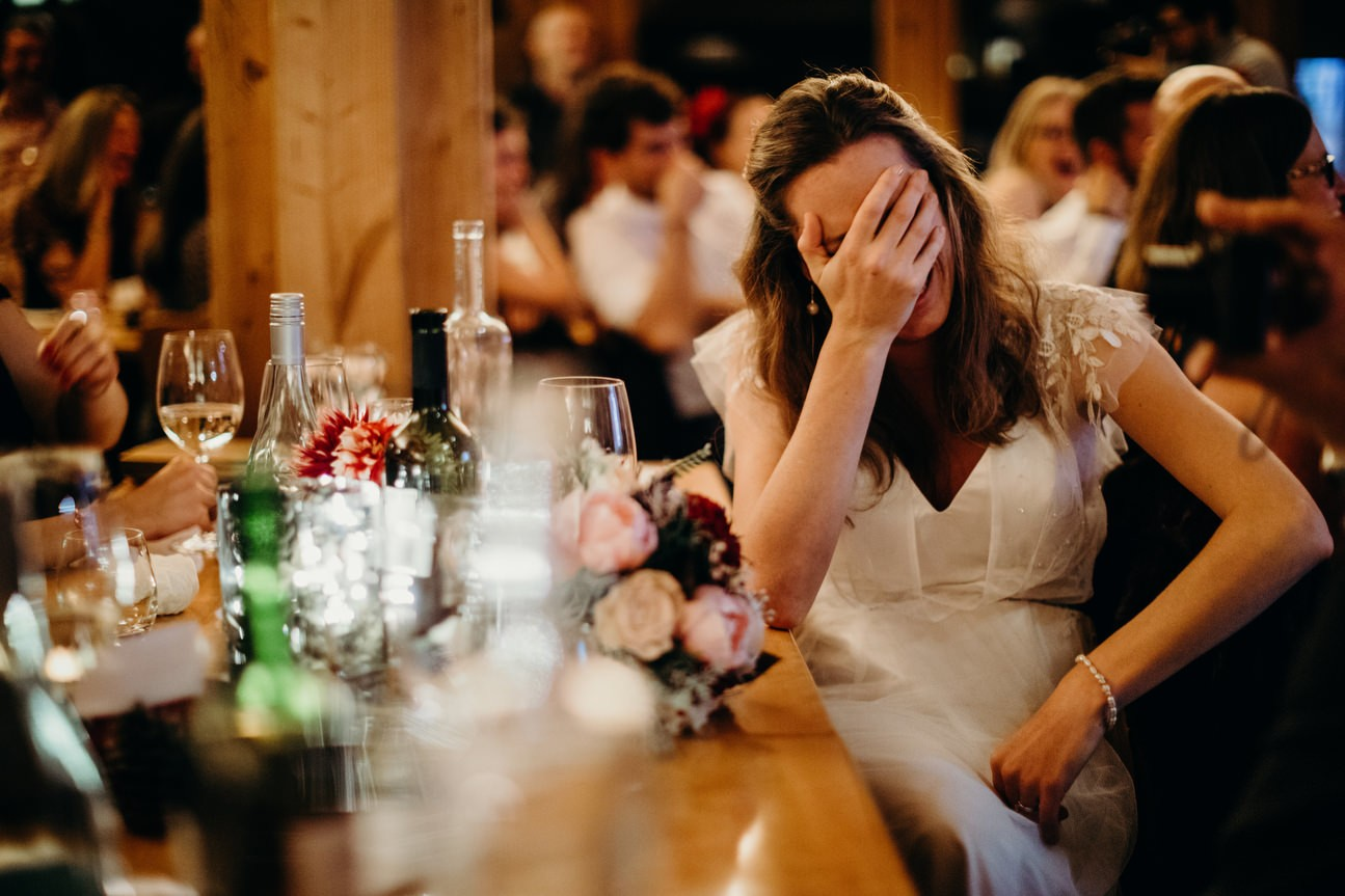 bride with hand in head during speeches