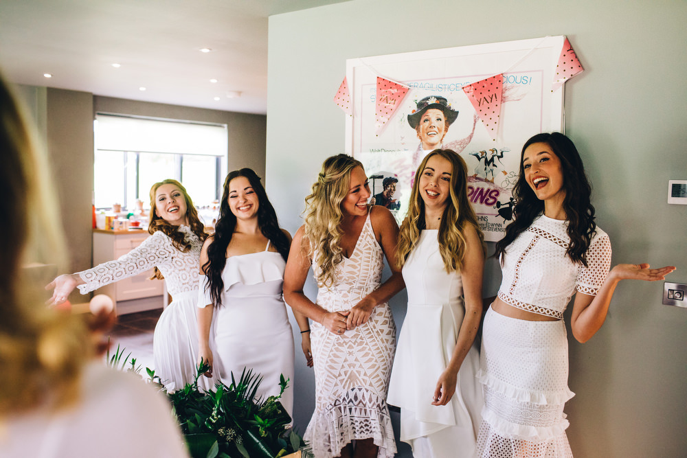 natural photograph of bridesmaids laughing