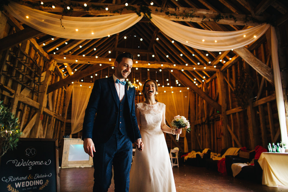 couple make entrance at barn wedding