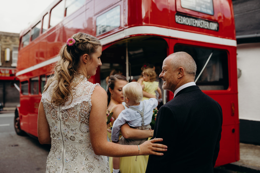 natural wedding photograph of Bride and father