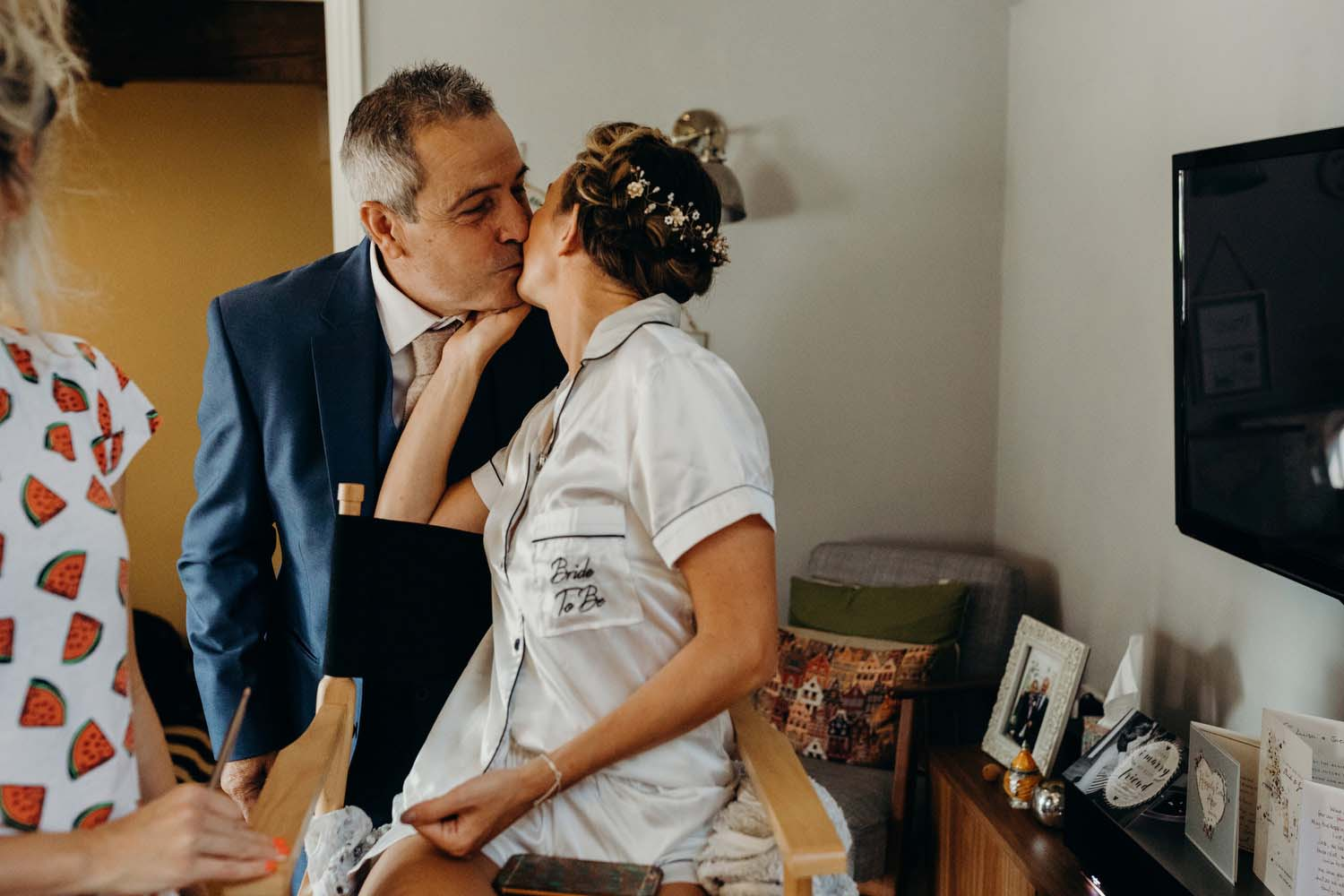 Father kisses bride on morning of wedding