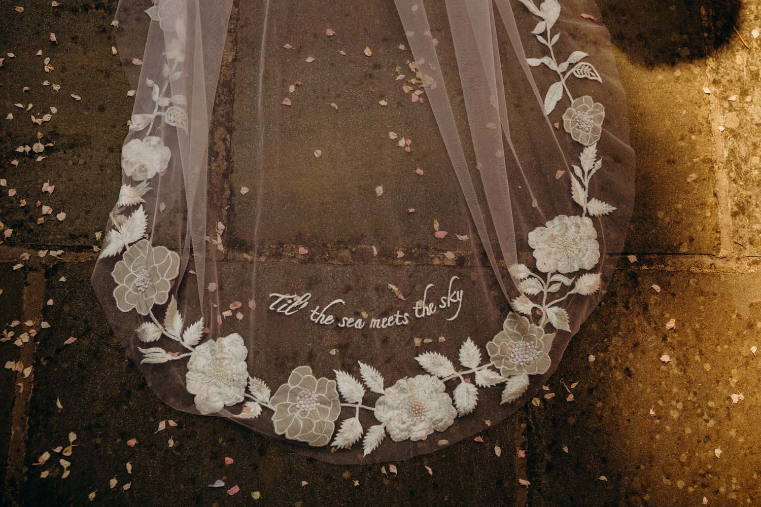 Hand stitched words on veil