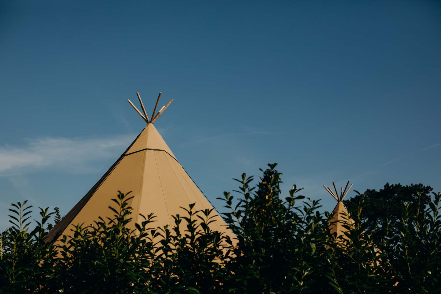 Tipi poking out to sky