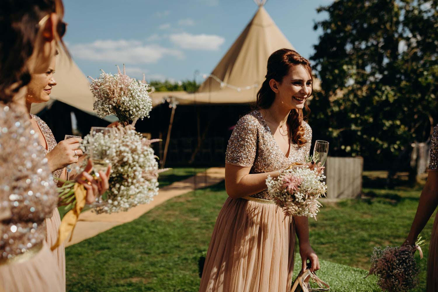 Bridesmaid laughing at tipi wedding
