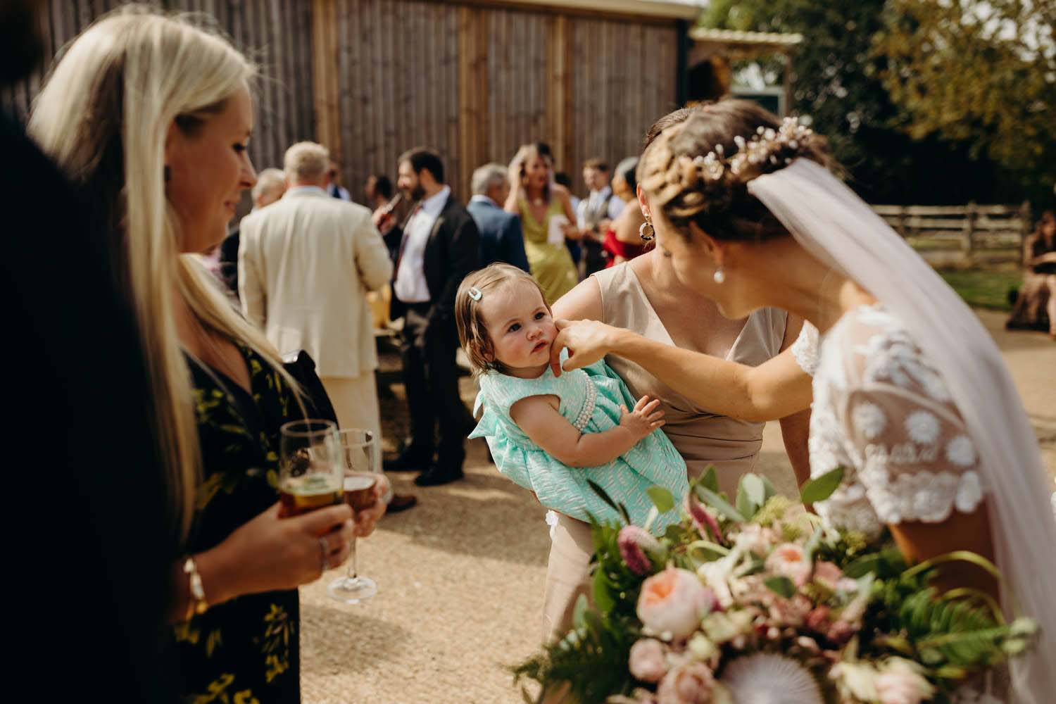 Bride says hello to toddler
