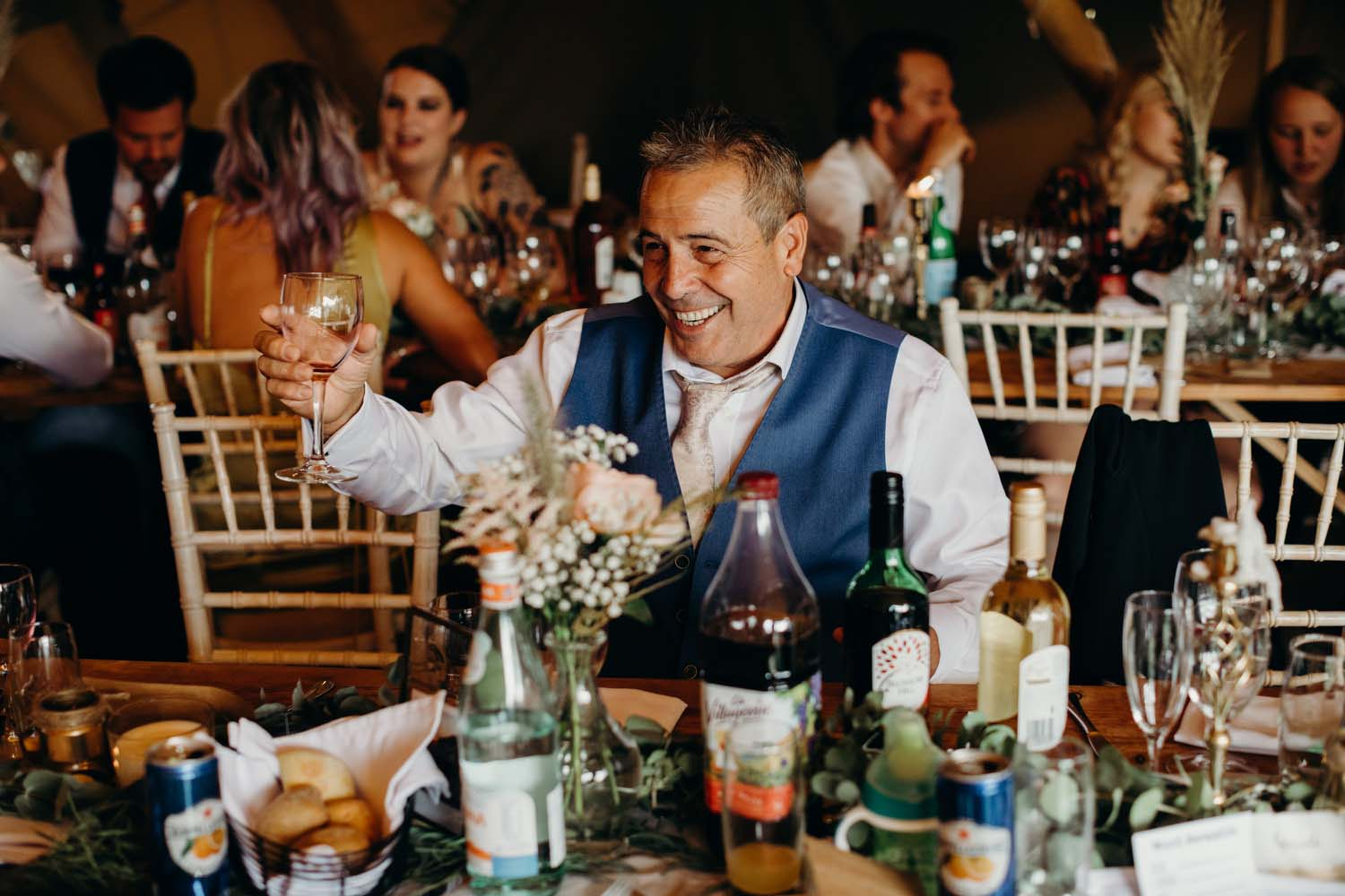 Father of bride raises glass