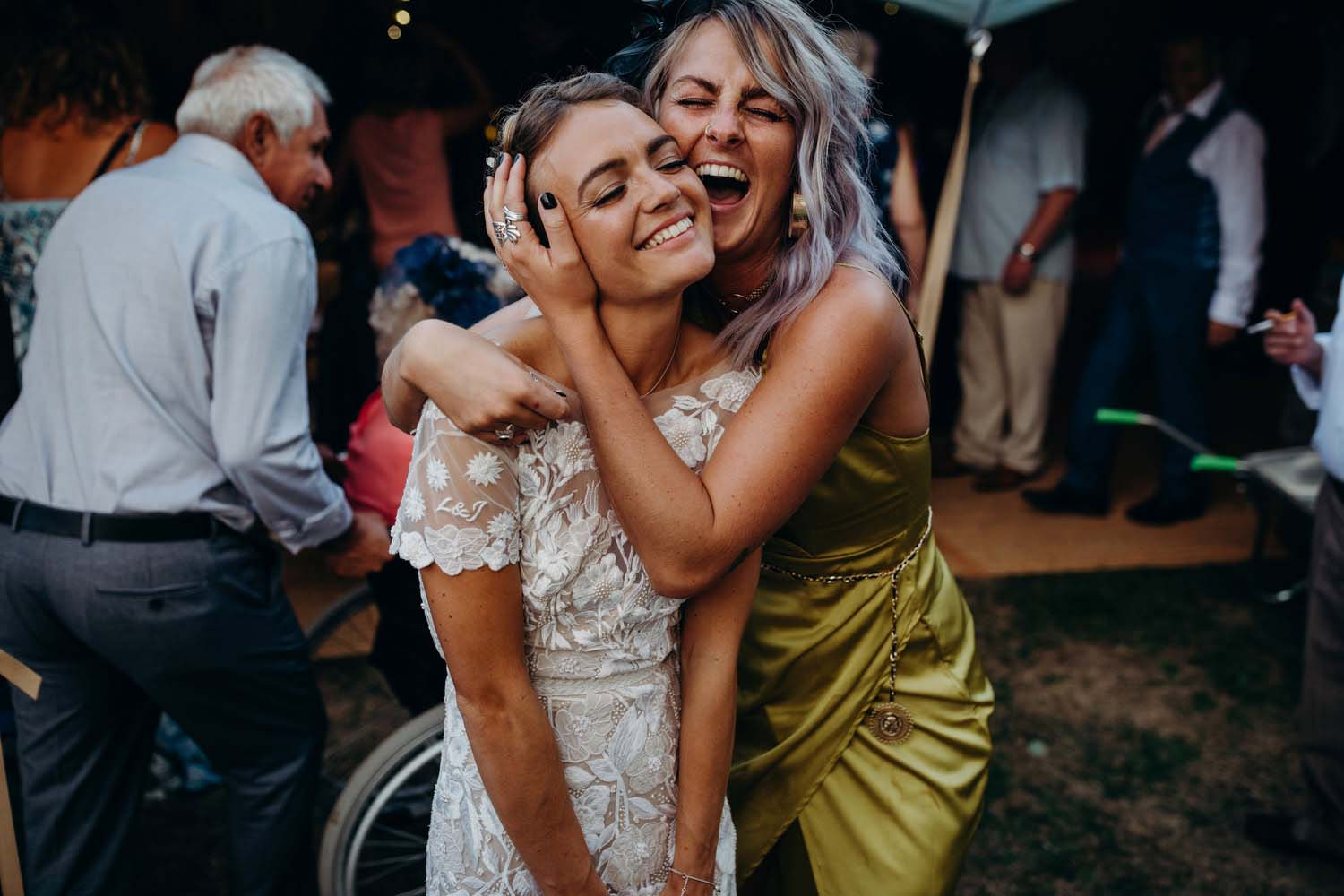 bride being hugged by friend