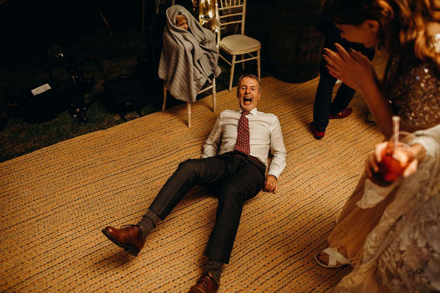 man falls over at wedding