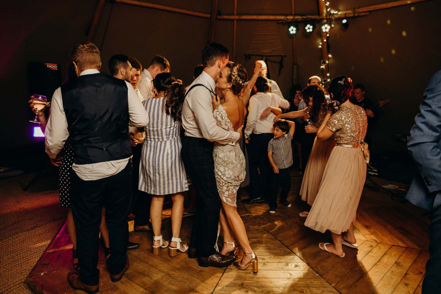 Bride and groom dance in tipi