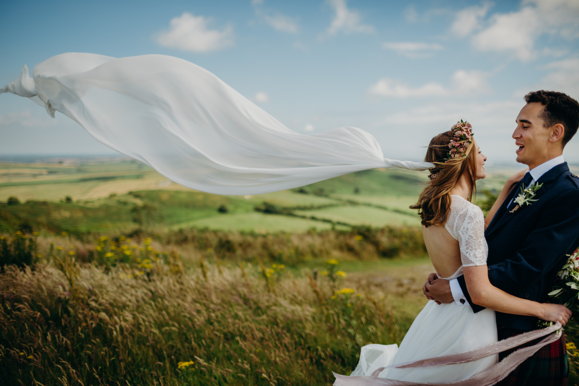 Veil blows in wind at hardy monument wedding