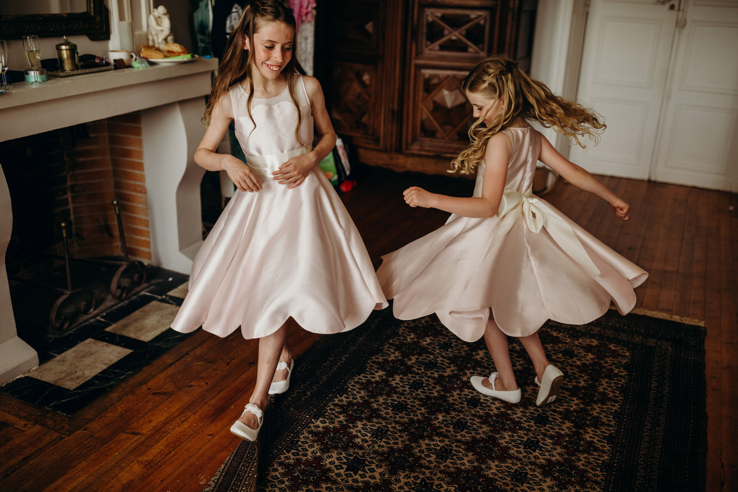 flower girls spin in their dresses
