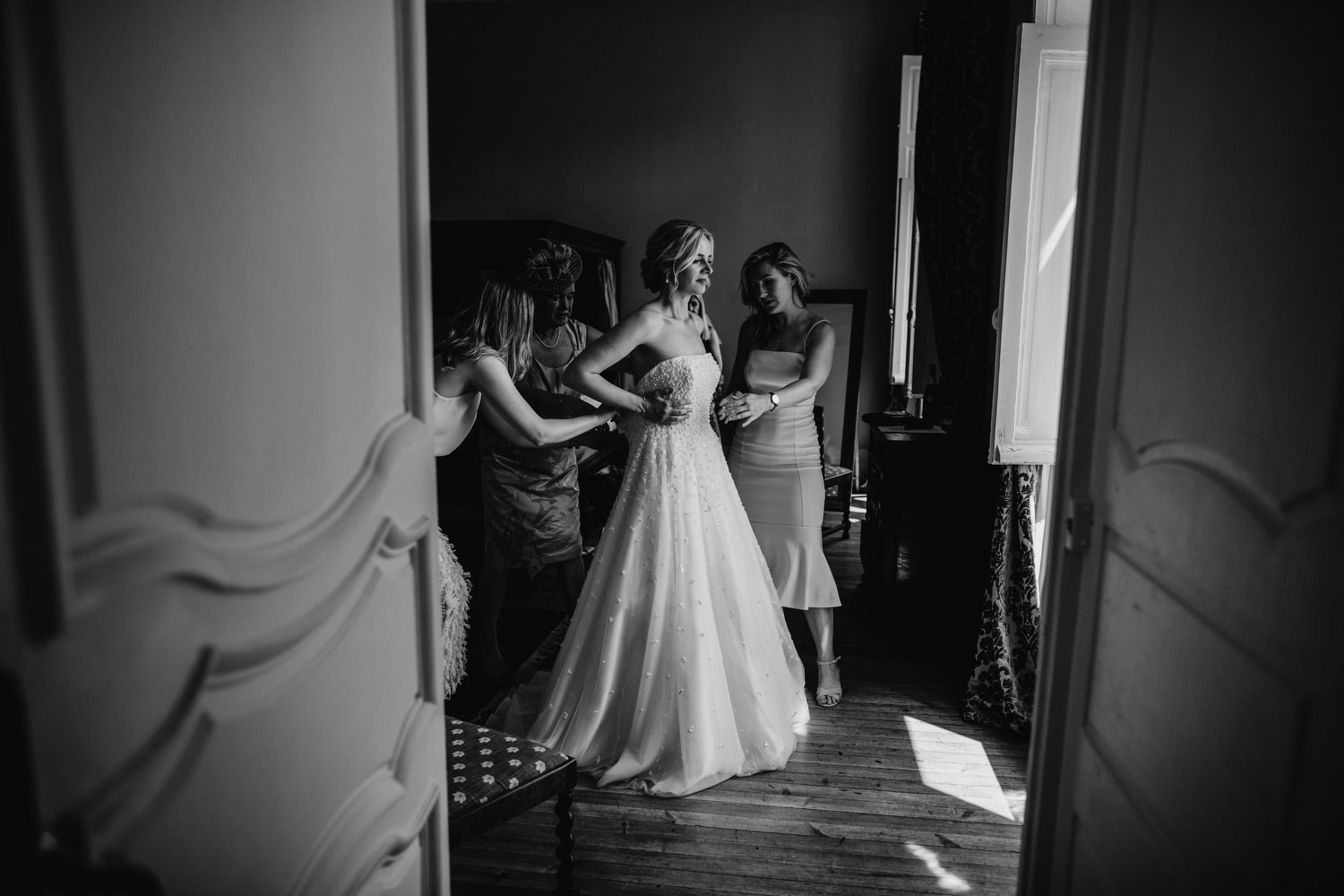 window lights up bride as she puts dress on
