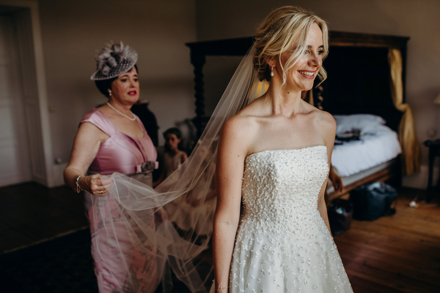 brides mother helping with veil