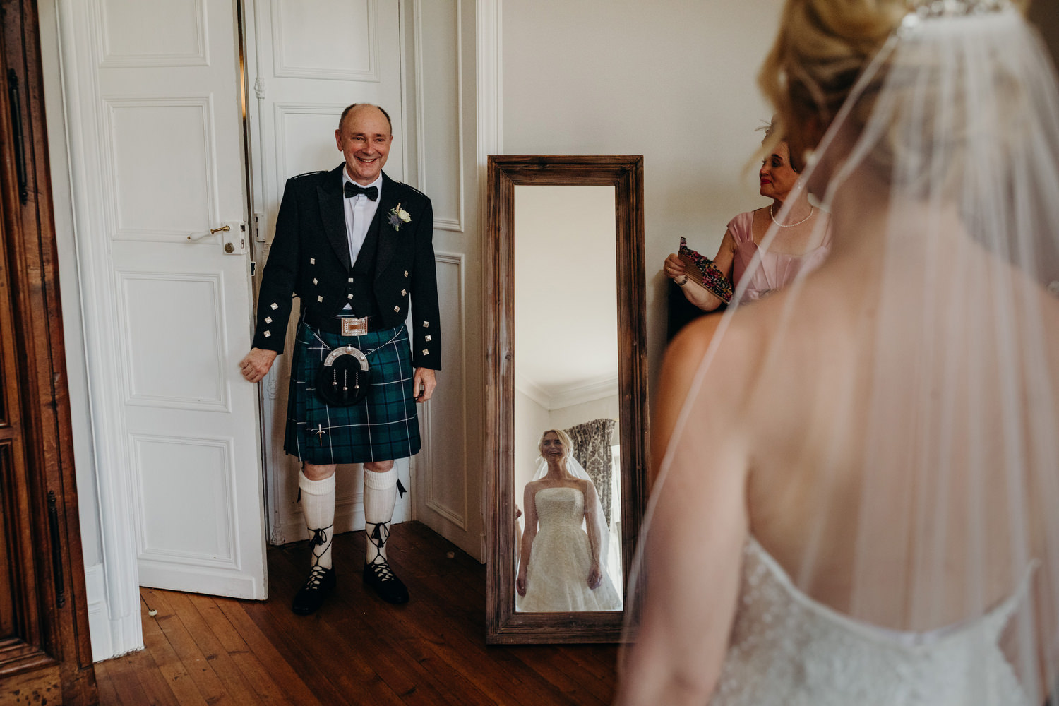 father of bride sees her in dress for first time