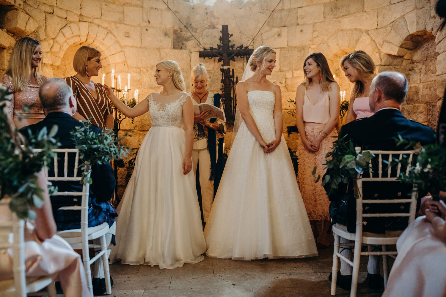 brides with friends during ceremony