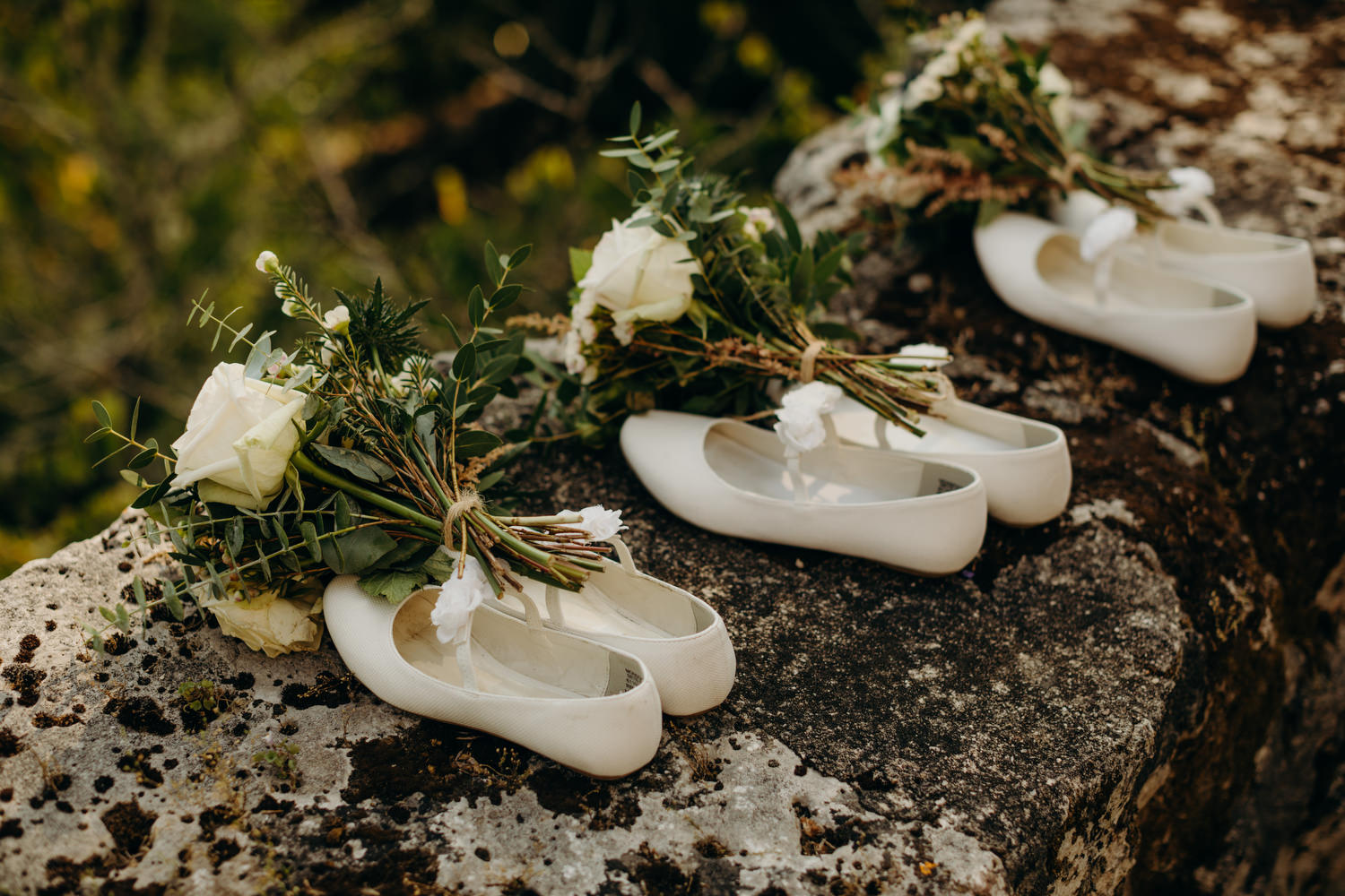 flower girls shoes and bouquets