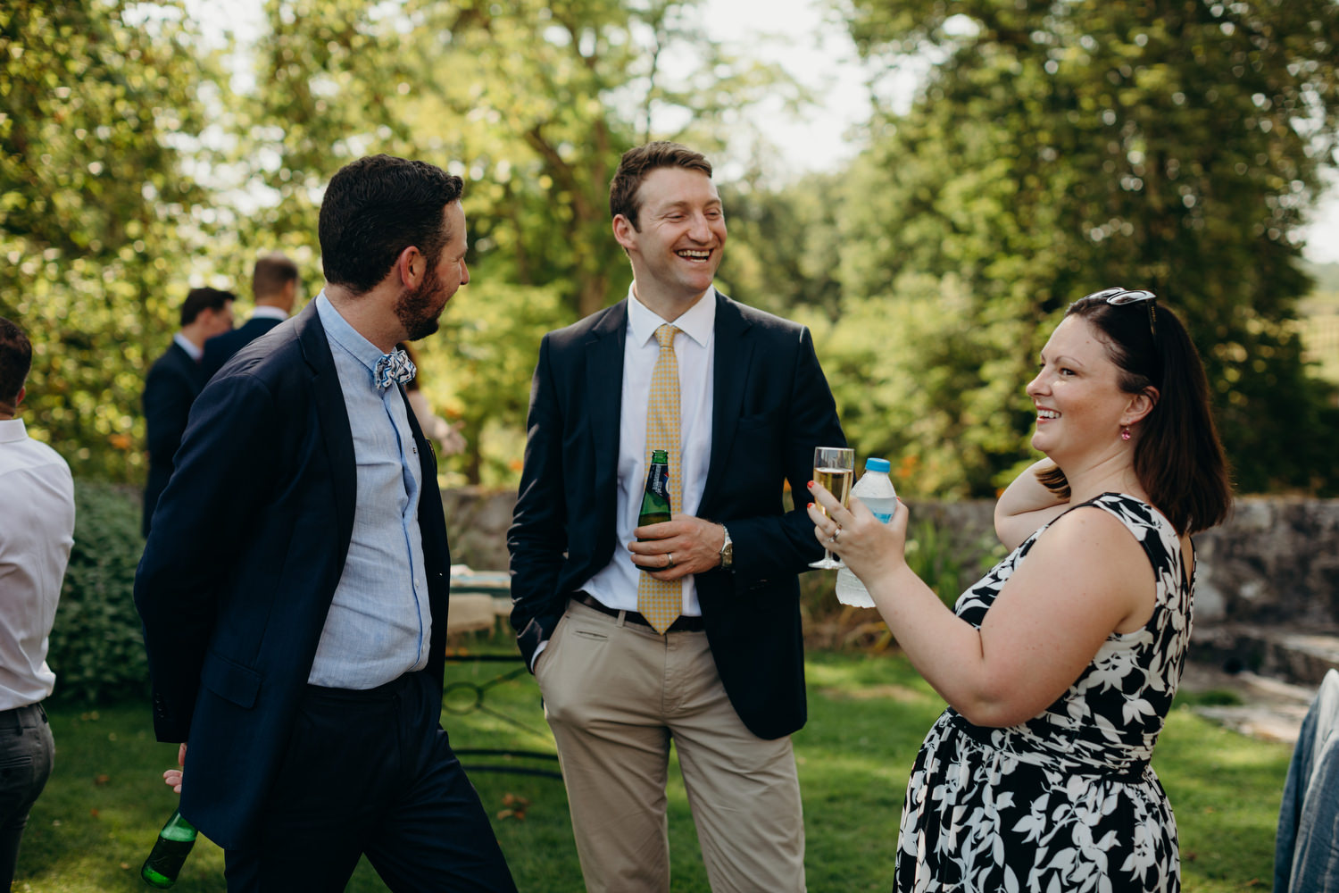 guest laugh during chateau drinks reception