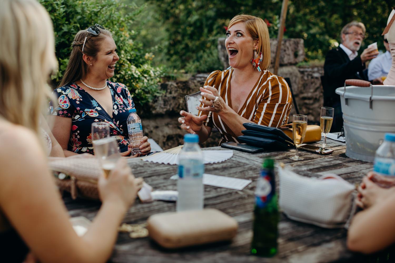 lady makes joke at wedding table