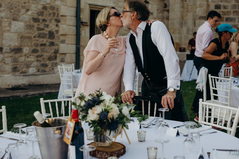 couple kiss at wedding