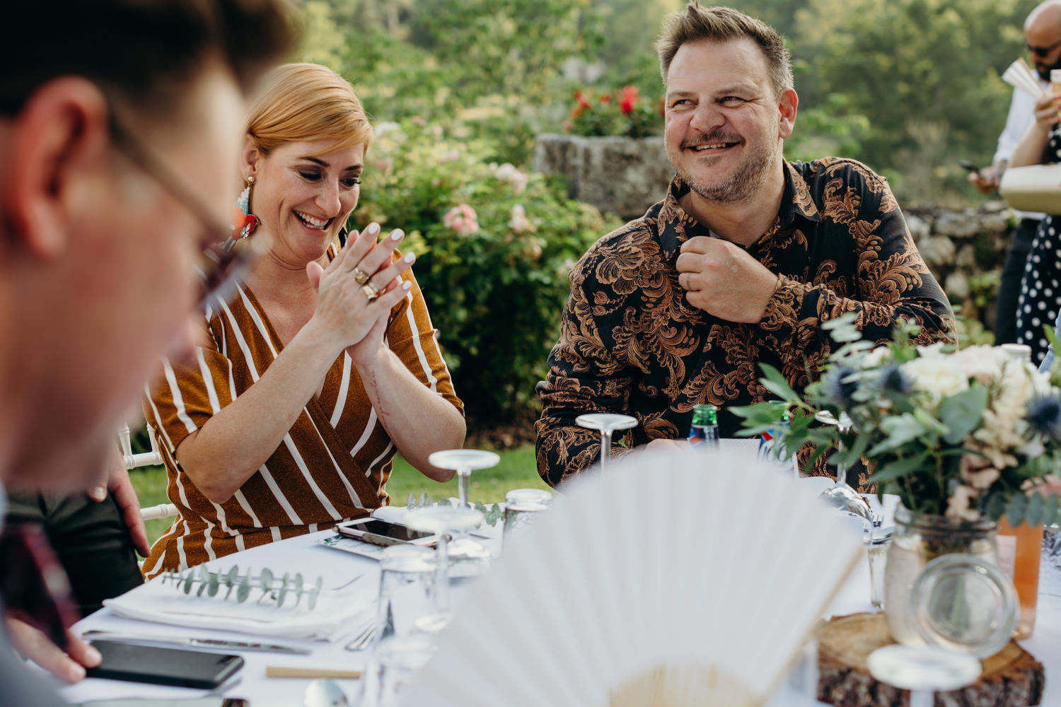guests laugh at wedding table