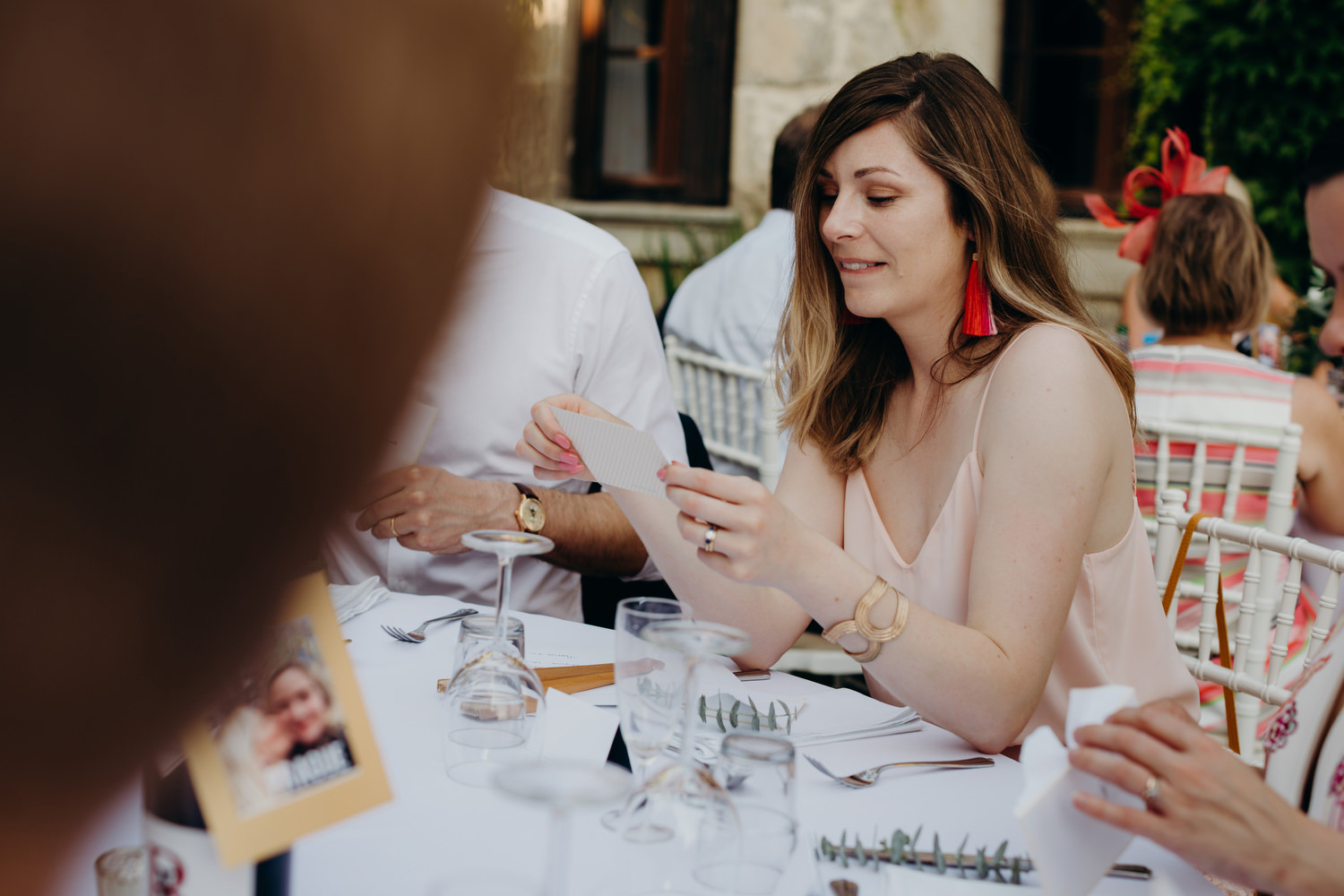guest reads a personalised note from couple