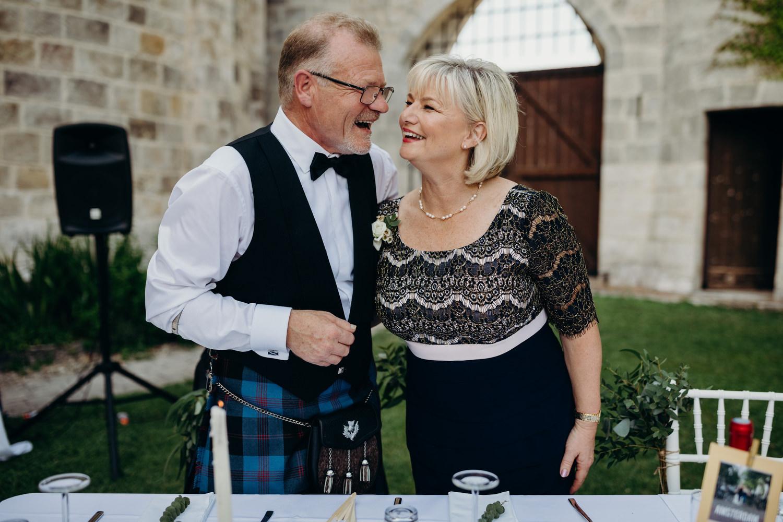 Parents of bride embrace