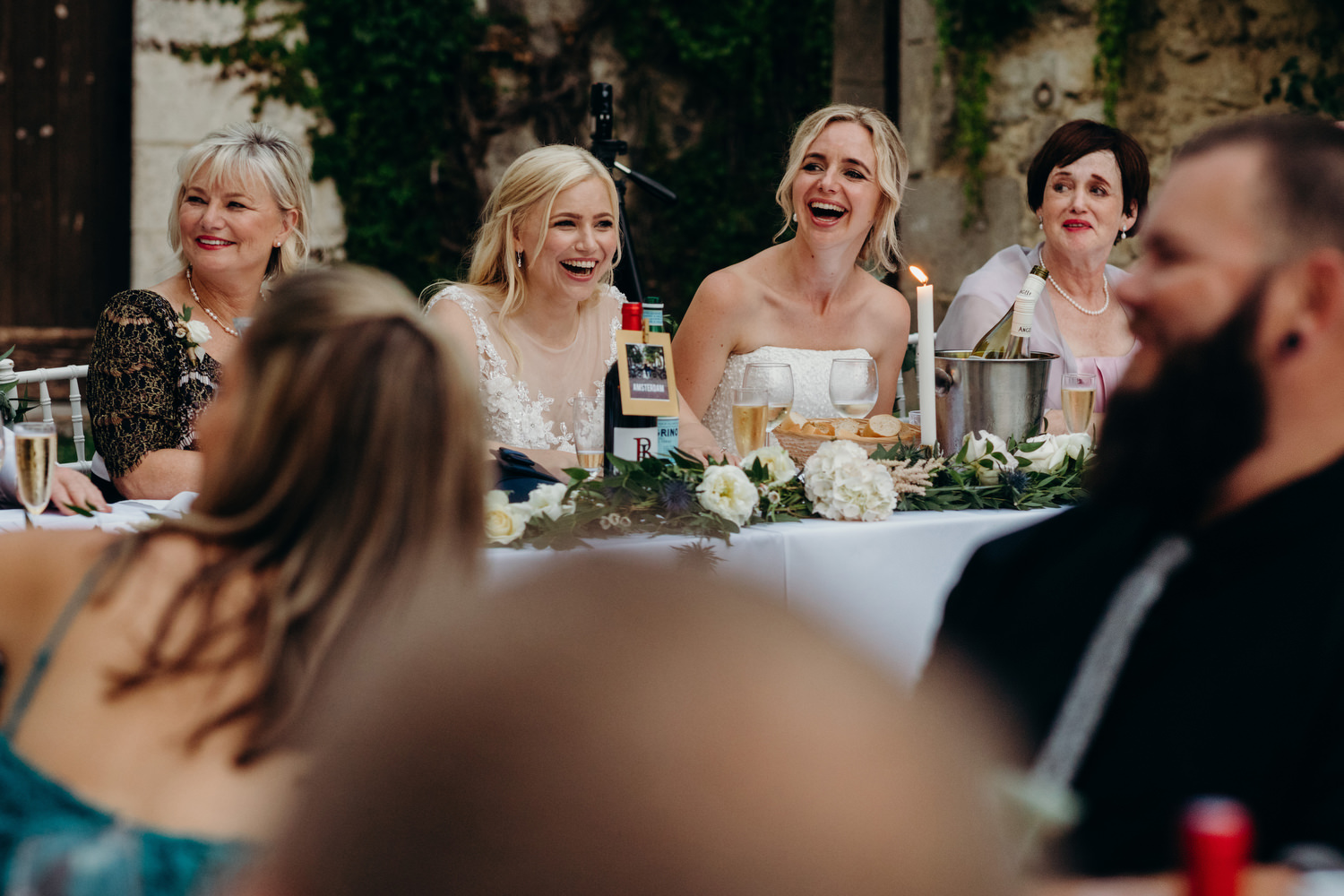 head table laughing during speeches